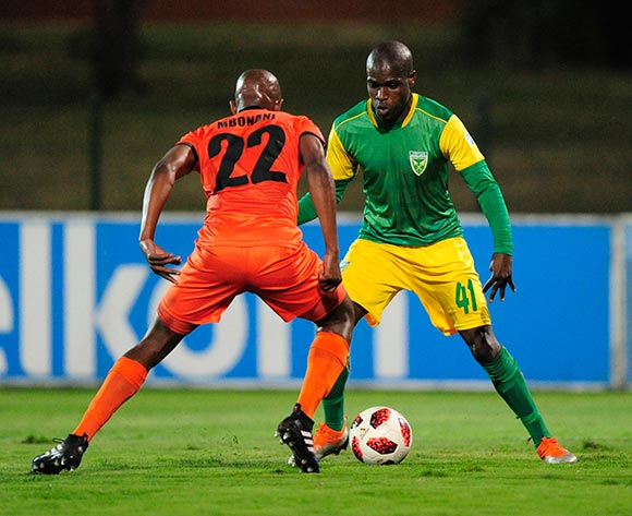 Sibusiso Mbonani of Polokwane City FC challenges Lerato Lamola of Lamontville Golden Arrows during the Absa Premiership 2018/19 game between Golden Arrows and Polokwane City at Princess Magogo Stadium on 29 August 2018 © Gerhard Duraan/BackpagePix