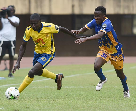 Kago Monyake of Township Rollers FC (Botswana) tries to challenge Patrick Henry Kaddu of KCCA FC (Uganda) during the 2018 Caf Champions League on 18 August 2018 at Mandela Stadium, Namboole, Kampala. ©Ismail Kezaala/BackpagePix