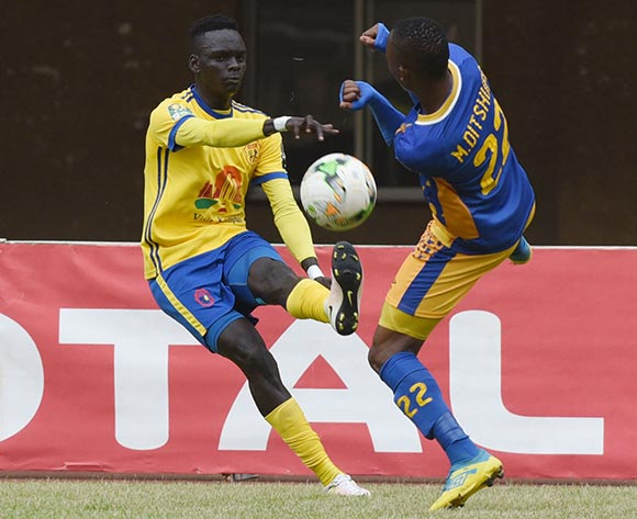 Maano Ditshupo of Township Rollers FC (Botswana) tries to challenge Mustafa Kizza of KCCA FC (Uganda) during the 2018 Caf Champions League on 18 August 2018 at Mandela Stadium, Namboole, Kampala. ©Ismail Kezaala/BackpagePix