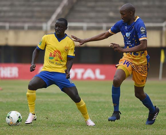Obuile Ncenga of Township Rollers FC (Botswana) tries to challenge Muzamiru Mutyaba of KCCA FC (Uganda) during the 2018 Caf Champions League on 18 August 2018 at Mandela Stadium, Namboole, Kampala. ©Ismail Kezaala/BackpagePix