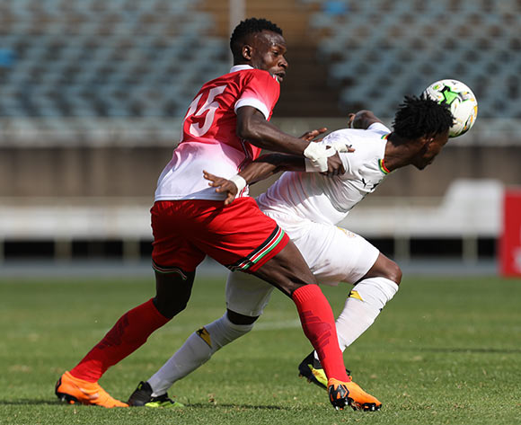 epa07005898 Kenya's Philemon Otieno (L) and Ghana's Christian Atsu (R) fight for the ball during the 2019 Africa Cup of Nations (AFCON) qualifier match between Kenya and Ghana at the Kasarani Stadium in Nairobi, Kenya, 08 September 2018.  EPA/Daniel Irungu