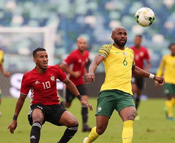 Ramahlwe Mphahlele of South Africa clears ball from Hamdou Elhouni of Libya during the 2019 African Cup Of Nations Qualifier match between South Africa and Libya at the Moses Mabhida Stadium, Durban on 08 September 2018 ©Muzi Ntombela/BackpagePix