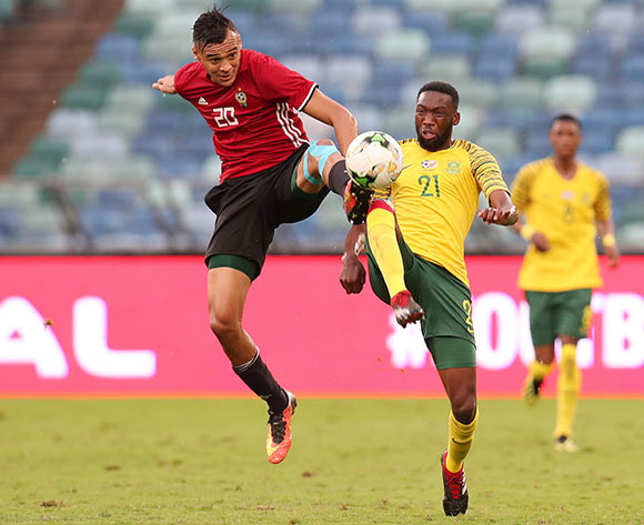 Buhle Mkhwanazi of South Africa challenged by Anias Mohamed Jummah Saltou of Libya during the 2019 African Cup Of Nations Qualifier match between South Africa and Libya at the Moses Mabhida Stadium, Durban on 08 September 2018 ©Muzi Ntombela/BackpagePix