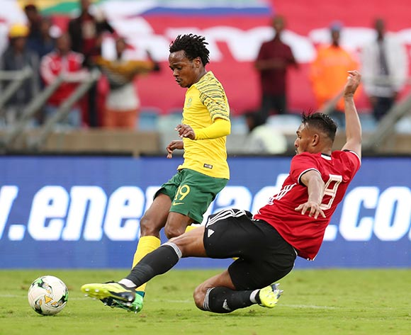 Percy Tau of South Africa tackled by Sand Masaud Masaud of Libya during the 2019 African Cup Of Nations Qualifier match between South Africa and Libya at the Moses Mabhida Stadium, Durban on 08 September 2018 ©Muzi Ntombela/BackpagePix