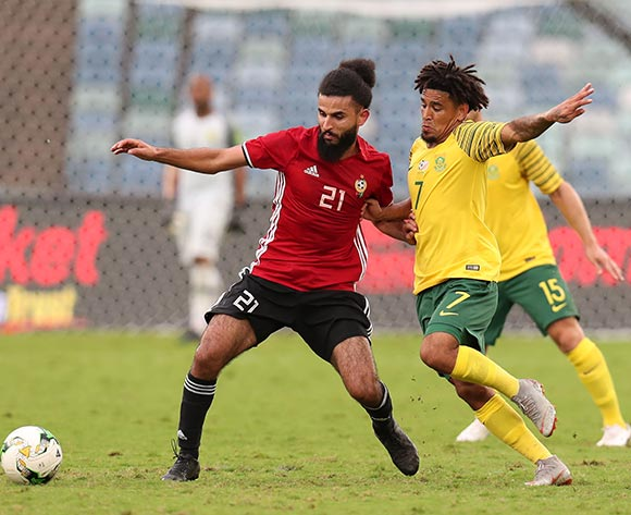 Rabia Ramadan Alsshadi of Libya challenged by Keagan Dolly of South Africa during the 2019 African Cup Of Nations Qualifier match between South Africa and Libya at the Moses Mabhida Stadium, Durban on 08 September 2018 ©Muzi Ntombela/BackpagePix