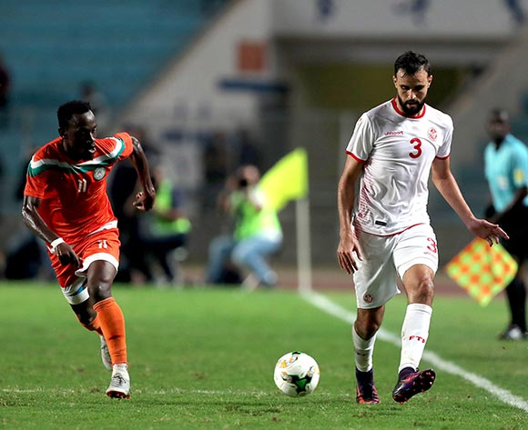 epa07092468 Tunisian player Hamdi Naguez (R) and Niger player   Amadou Djibox Mohamed  (L) fight for the ball during 2019 Africa Cup of Nations qualifier match between Tunisia and Niger at the Olympic Stadium of Rades in Tunis, Tunisia, 13 October 2018.  EPA/MOHAMED MESSARA This image is intended for Editorial use (e.g. news articles). Any commercial use (e.g. ad campaigns) requires additional clearance. Contact: photo@backpagemedia.co.za for more information