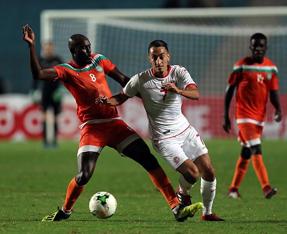 epa07092472 Tunisian player Seifeddie Khaoui  (C) and Niger player Dramane Diarate Ousma (L) fight for the ball during 2019 Africa Cup of Nations qualifier match between Tunisia and Niger at the Olympic Stadium of Rades in Tunis, Tunisia, 13 October 2018.  EPA/MOHAMED MESSARA This image is intended for Editorial use (e.g. news articles). Any commercial use (e.g. ad campaigns) requires additional clearance. Contact: photo@backpagemedia.co.za for more information