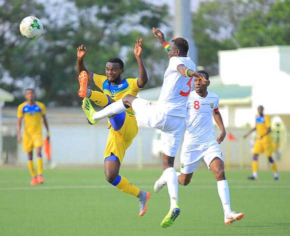 Djabel Manishimwe of Rwanda best to the ball ahead of Issiaga Sylla of Guinea during the 2019 Afcon qualifier between Rwanda and Guinea at Nyamirambo Stadium in Kigali, Rwanda on 16 October 2018  © Julius Ntare/BackpagePix