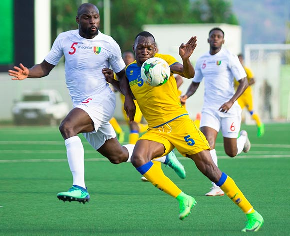 Meddie Kagere of Rwanda and Ernest Seka Boka of Guinea battle for possession during the 2019 Afcon qualifier between Rwanda and Guinea at Nyamirambo Stadium in Kigali, Rwanda on 16 October 2018  © Julius Ntare/BackpagePix