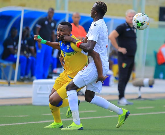 Jacques Tuyisenge of Rwanda takes on Issiaga Sylla of Guinea during the 2019 Afcon qualifier between Rwanda and Guinea at Nyamirambo Stadium in Kigali, Rwanda on 16 October 2018  © Julius Ntare/BackpagePix
