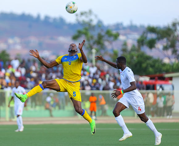 Meddie Kagere of Rwanda wins the header as Ibrahima Sory Conte of Guinea looks on during the 2019 Afcon qualifier between Rwanda and Guinea at Nyamirambo Stadium in Kigali, Rwanda on 16 October 2018  © Julius Ntare/BackpagePix