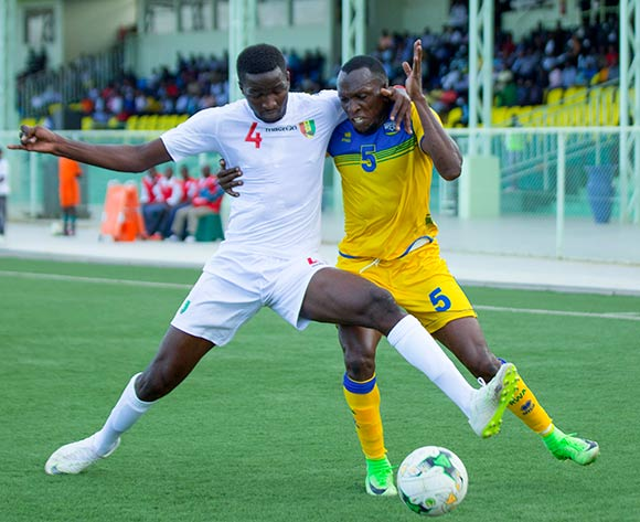 Ibrahima Sory Conte of Guinea and Meddie Kagera of Rwanda during the 2019 Afcon qualifier between Rwanda and Guinea at Nyamirambo Stadium in Kigali, Rwanda on 16 October 2018  © Julius Ntare/BackpagePix