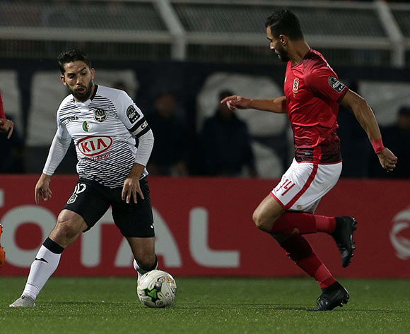 ES Setifienne player Abdelmoumen Djabou (L) and Al Ahly Sporting Club player Amro Elsoulia (R) fight for the ball during the CAF Champions League game between ES Setifienne and Al Ahly at the 8 May 1945 Stadium in Setif on 23 October 2018.