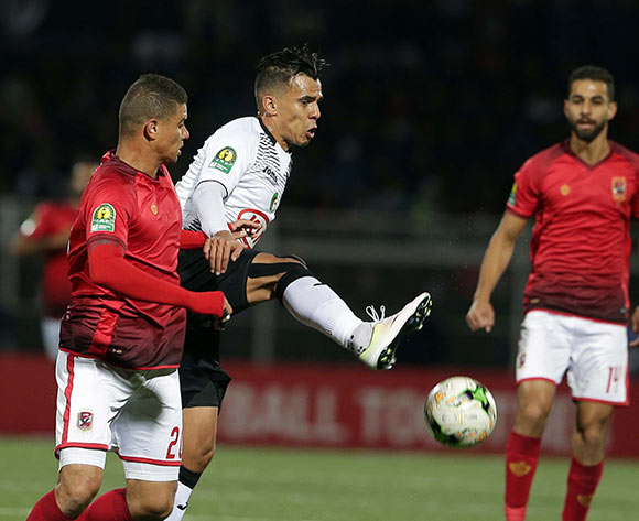 ES Setifienne player Elhabib Bouguelmouna (R) and Al Ahly Sporting Club player  Saadeldin Samir Saad Ali (L) fight for the ball during the CAF Champions League game between ES Setifienne and Al Ahly at the 8 May 1945 Stadium in Setif on 23 October 2018.