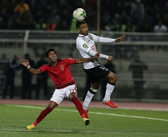 ES Setifienne player Houari Ferhani (R) and Al Ahly Sporting Club player Ahmed abd Elgaber (L) fight for the ball during the CAF Champions League game between ES Setifienne and Al Ahly at the 8 May 1945 Stadium in Setif on 23 October 2018.