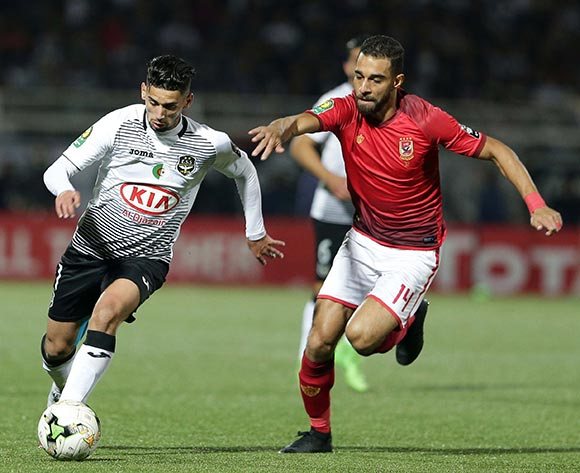 ES Setifienne player Samir Aiboud (L) and Al Ahly Sporting Club player Amro Elsoulia (R) fight for the ball during the CAF Champions League game between ES Setifienne and Al Ahly at the 8 May 1945 Stadium in Setif on 23 October 2018.
