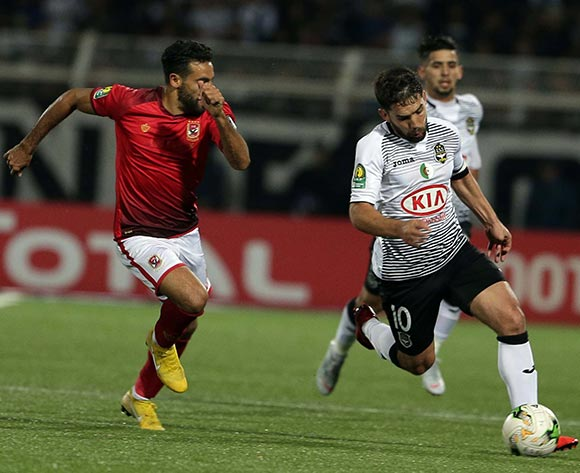 ES Setifienne player Abdelmoumen Djabou (L) and Al Ahly Sporting Club player Mouhamed Hussein (R) fight for the ball during the CAF Champions League game between ES Setifienne and Al Ahly at the 8 May 1945 Stadium in Setif on 23 October 2018.