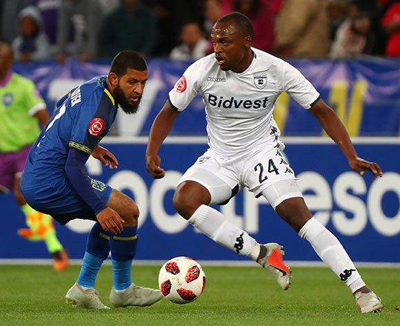 Gift Motupa of Bidvest Wits evades challenge from Riyaad Norodien of Cape Town City during the Absa Premiership 2018/19 football match between Cape Town City FC and Bidvest Wits at Cape Town Stadium, Cape Town on 2 October 2018 ©Chris Ricco/BackpagePix