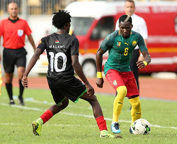 Ambroise Onyongo Bitolo of Cameroon and Yamikani Chester of Malawi during the 2019 Afcon qualifying football match between Cameroon and Malawi at the Hamadou Ahidjo Stadium in Yaounde, Cameroon on 12 October 2018 ©Alain Suffo/BackpagePix