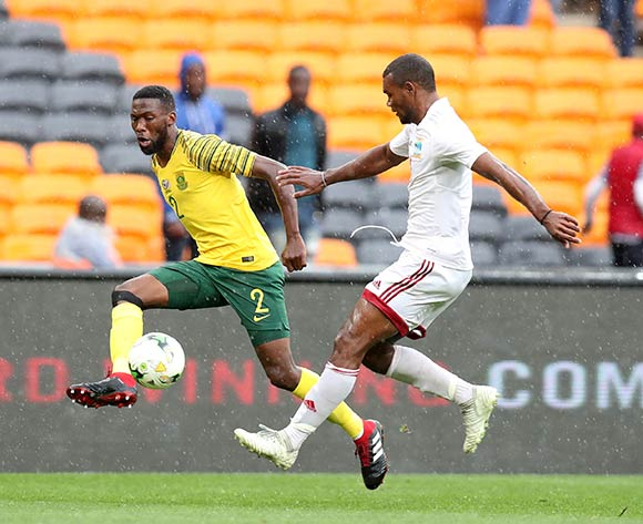 Buhle Mkhwanazi of South Africa challenged by Perry Monnaie of Seychelles during the 2019 African Cup of Nations match between South Africa and Seychelles at the FNB Stadium, Johannesburg on 13 October 2018 ©Muzi Ntombela/BackpagePix