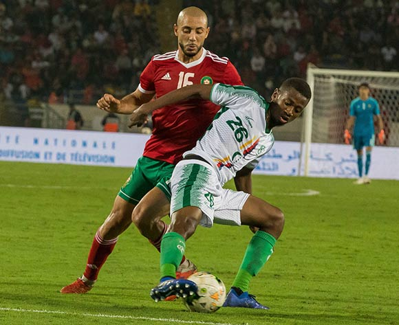 Nations morocco player amrabat (R) and Comoros player mdahoma kassim (L) fight for the ball during the qualifiers for the African Cup of Nations morocco and Comoros at Mohamed V Stadium in Casablanca , Morocco, 13 October 2018.