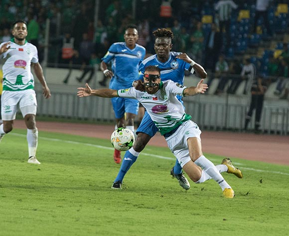 Raja Club Athletic player ZAKARIA HADRAF  (R) and Enyimba FC player ANDREW ABALOGU (L) fight for the ball during the African Confederation Cup match between Raja Club Athletic of Morocco and Enyimba FC of Nigeria, on 24 October 2018 at Mohamed V Stadium in Casablanca, Morocco