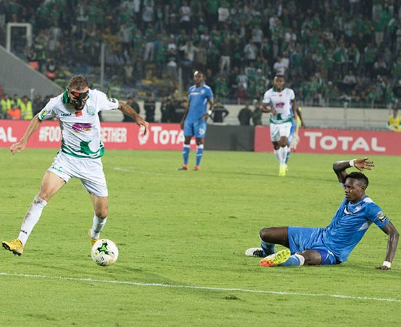 Raja Club Athletic player ZAKARIA HADRAF(r) and Enyimba FC player ISIAKA OLADUNTOYE (L) fight for the ball during the African Confederation Cup match between Raja Club Athletic of Morocco and Enyimba FC of Nigeria, on 24 October 2018 at Mohamed V Stadium in Casablanca, Morocco