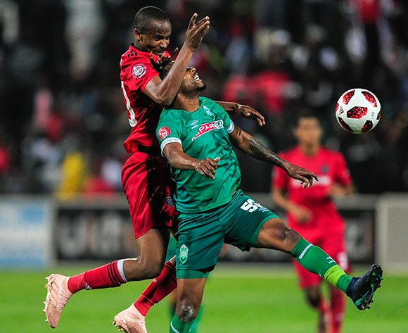 Xola Mlambo of Orlando Pirates and Nhlanhla Vilakazi of AmaZulu FC compete for the ball during the Absa Premiership 2018/19 game between AmaZulu and Orlando Pirates at King Zwelithini Stadium, Durban on 6 October 2018 © Gerhard Duraan/BackpagePix