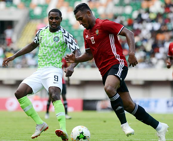 Odion Ighalo of Nigeria and Sand Masaud of Libya  during the 2019 Africa Cup of Nations qualifier football match between Nigeria and Libya at Akwa Ibom International Stadium, Akwa Ibom State, Nigeria on 13 October 2018 @Kabiru Abubakar/BackpagePix