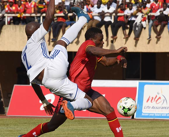 Edrisa Lubega of Uganda evades a tackle from Mafa Moremoholo of Lesotho during the 2019 Afcon Qualifier on 13 October 2018 at Mandela Stadium, Namboole, Kampala. ©Ismail Kezaala/BackpagePix