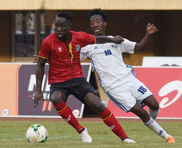 Denis Iguma of Uganda evades challenge from Tumelo Khutlang of Lesotho during the 2019 Afcon Qualifier on 13 October 2018 at Mandela Stadium, Namboole, Kampala. ©Ismail Kezaala/BackpagePix