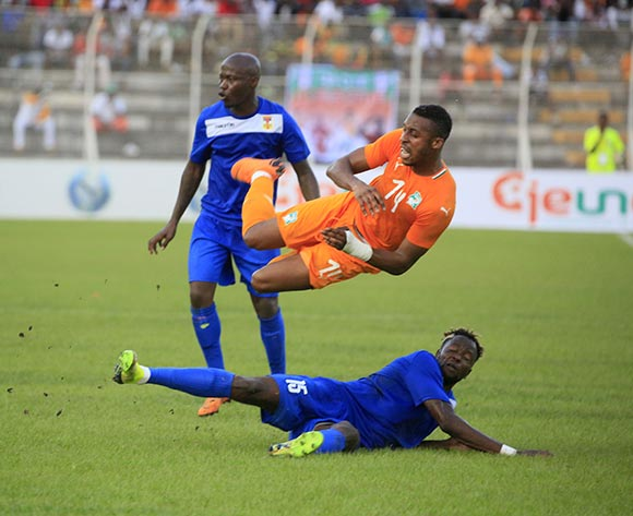 Kodjia Jonathan of Ivory Coast (top) vies for the ball with Zimbori Nicaise from Central African Republic during the African Cup of Nations CAN 2019 qualification football match between Ivory Coast and Central African Republic, at the Stade de la paix in Bouake on October 12, 2018.