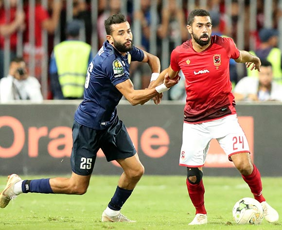 epa07137919 Ahmed Fathy (R) of Al Ahly fights for the ball with Ghaylen Chaaleli  of ES Tunis during the CAF Champions League final 1st leg match between Al Ahly and ES Tunis at Borg Al Arab Stadium in Alexandria, Egypt, 02 November 2018.  EPA/KHALED ELFIQI