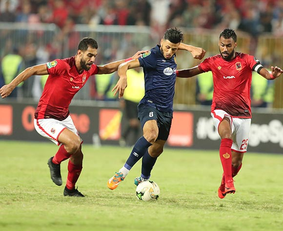 Amr Elsolia (L) Hossam Ashour (R) of Al Ahly fights for the ball with Anice Badri (C) of ES Tunis during the CAF Champions League final 1st leg match between Al Ahly and ES Tunis in Alexandria, Egypt, 02 November 2018.  EPA/KHALED ELFIQI