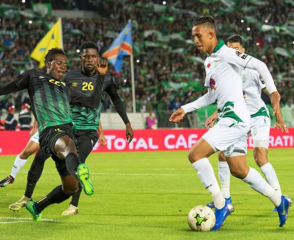 epa07190060 Raja Club Athletic's Soufiane Rahimi (R) in action against AS Vista Club's Mukoko Tonombe (L) during the CAF Confederation Cup final first leg, soccer match between Raja Club Athletic and AS Vita Club at Mohamed V Stadium in Casablanca, Morocco, 25 November 2018.  EPA/JALAL MORCHIDI