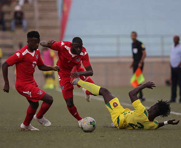 Namibia winger Deon Hotto breaks past Guinea Bissau defender Eliseu Cassama, with Hendrik Somaeb up in support, during their Afcon qualifier against Guinea Bissau in Windhoek on Saturday. The match ended in a 0-0 draw. Photo: Helge Schutz
