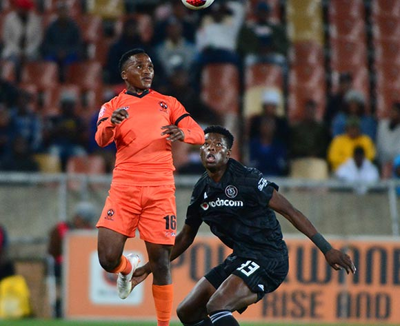 Bongile Booi of Polokwane City and Marshall Munetsi of Orlando Pirates during the Absa Premiership 2018/19 game between Polokwane City and Orlando Pirates at Peter Mokaba Stadium in Polokwane the on 06 Novermber 2018 © Kabelo Leputu/BackpagePix