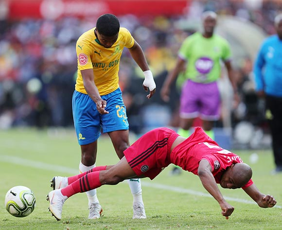 Thabo Qalinge of Orlando Pirates kicked by Lyle Lakay of Mamelodi Sundowns during the Absa Premiership 2018/19 match between Mamelodi Sundowns and Orlando Pirates at the Loftus Versveld Stadium, Pretoria on 10 November 2018 ©Muzi Ntombela/BackpagePix