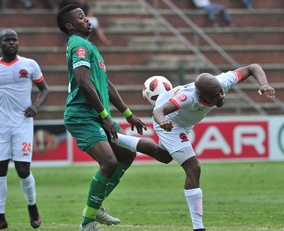 Bongi Ntuli of AmaZulu challenged by Sibusiso Mbonani of Polokwane City during the Absa Premiership 2018/19 match between AmaZulu and Polokwane City at King Zwelithini Stadium, Durban on 11 November 2018 ©Samuel Shivambu/BackpagePix