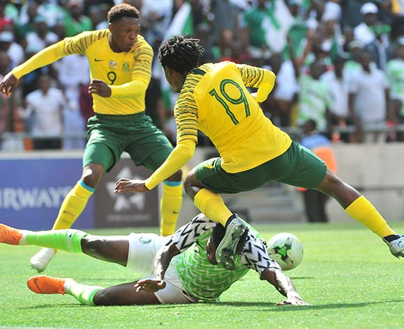 Percy Tau of South Africa challenged by Ojima Samuel Kalu of Nigeria during the 2019 African Cup of Nations Qualifier match between South Africa and Nigeria at FNB Stadium, Johannesburg on 17 November 2018 ©Samuel Shivambu/BackpagePix