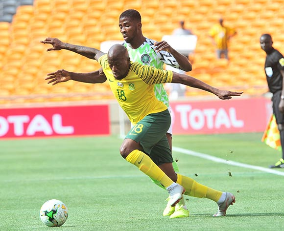 Sifiso Hlanti of South Africa challenged by Iheanacho Kelechi promise of Nigeria during the 2019 African Cup of Nations Qualifier match between South Africa and Nigeria at FNB Stadium, Johannesburg on 17 November 2018 ©Samuel Shivambu/BackpagePix