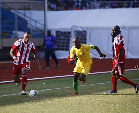 Liberian Player, Joel Alajarin Johnson (L) in action during AFCON 2019 qualifier match between Liberia and Zimbabwe at the Samuel Kanyon Doe Sport Complex in Paynesville, outside Monrovia, Liberia. 18th November 2018. Liberia 1 Zimbabwe 0