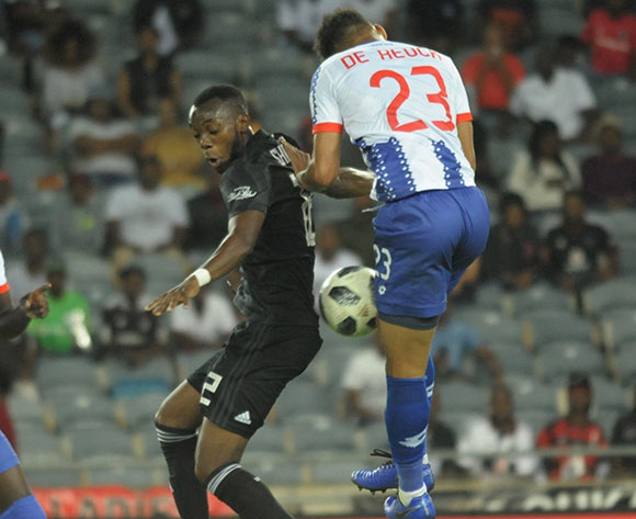 Justin Shonga of Orlando Pirates challenged by Rushine De Reuck of Maritzburg United during the Absa Premiership 2018/19 game between Orlando Pirates and Maritzburg United at Orlando Stadium ,South Africa on 01 December 2018 ©Aubrey Kgakatsi/BackpagePix