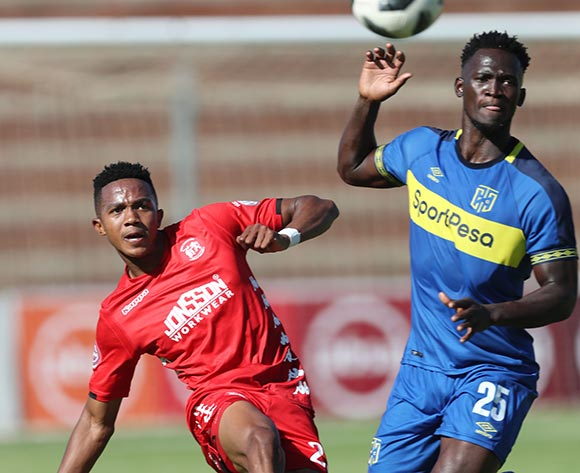 Spiwe Msimango of Highlands Park clears ball from Siphelele Mthembu of CT City during the Absa Premiership 2018/19 football match between Highlands Park and Cape Town City at Makhulong Stadium, Tembisa on 01 December 2018 ©Gavin Barker/BackpagePix