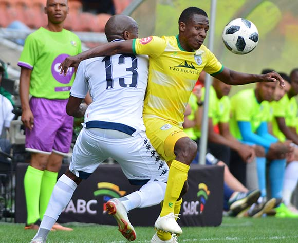 Sfiso Hlanti of Bidvest Wits and Talent Chawapihwa of Baroka FC during the Absa Premiership 2018/19 game between Baroka FC and Bidvest Wits at Peter Mokaba Stadium in Polokwane the on 16 December 2018 © Kabelo Leputu/BackpagePix