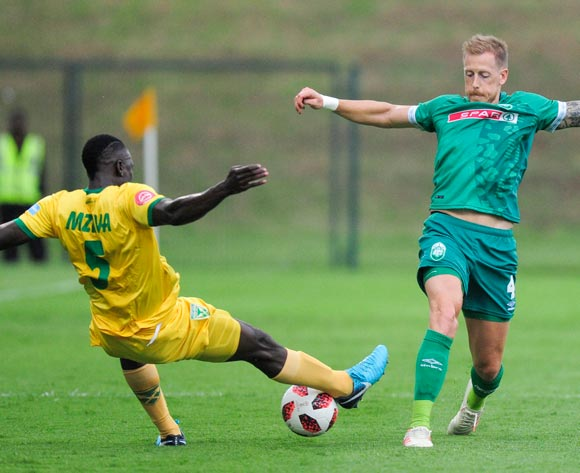 Limbikani Mzava of Lamontville Golden Arrows gets to the ball before Michael Morton of AmaZulu FC during the Absa Premiership 2018/19 game between AmaZulu FC and Golden Arrows at King Zwelithini Stadium, Durban on 22 December 2018 ©Gerhard Duraan/BackpagePix