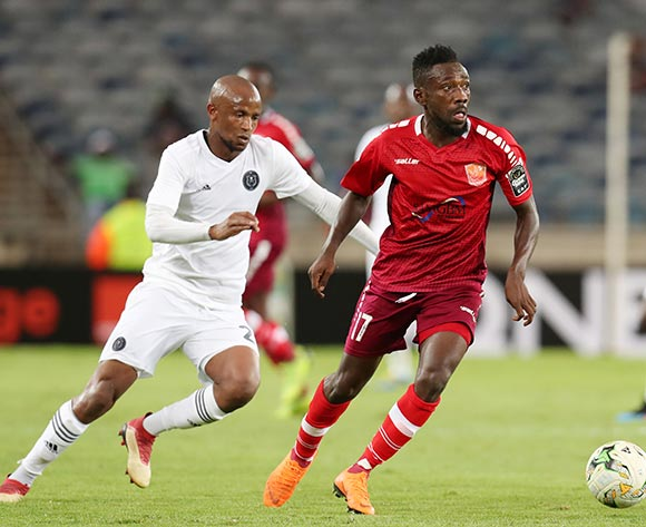 Sebe Baffour Kyei of Horoya challenged by Xola Mlambo of Orlando Pirates during the 2019 TOTAL CAF Champions League match between Orlando Pirates and Horoya at the Orlando Stadium, Soweto on the 18 January 2019 ©Muzi Ntombela/BackpagePix