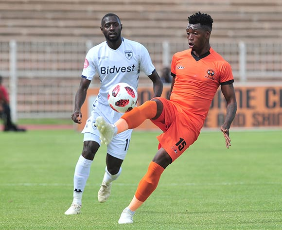 Walter Musona of Polokwane City challenged by Deon Hotto of Bidvest Wits during the Absa Premiership 2018/19 match between Polokwane City and Bidvest Wits at Old Peter Mokaba Stadium, Polokwane on 20 January 2019 ©Samuel Shivambu/BackpagePix