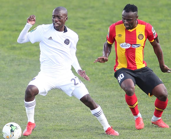 Ben Motshwari of Pirates and Franck Kom of Esperance during the 2018/19 CAF Champions League football match between Esperance and Pirates in Menzeh, Tunisia on 12 February 2019 @BackpagePix