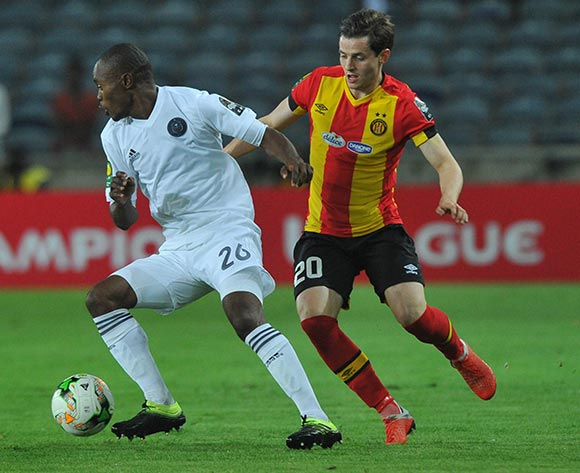 Ayman Ben Mohamed of Esperance challenged by Asavela Mbekile of Orlando Pirates during the CAF Champions League match between Orlando Pirates and Esperance 02 February 2019 at Orlando Stadium  Pic Sydney Mahlangu/ BackpagePix